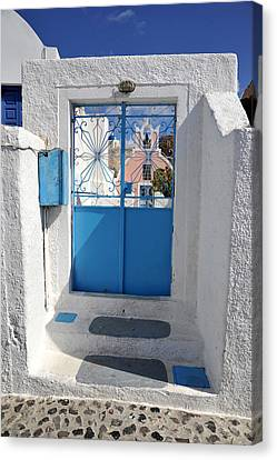 Canvas Print featuring the photograph Santorini Greece by John Jacquemain