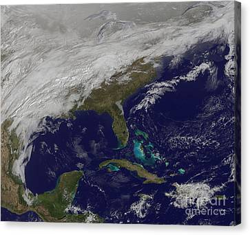 Satellite View Of A Major Winter Storm Canvas Print by Stocktrek Images