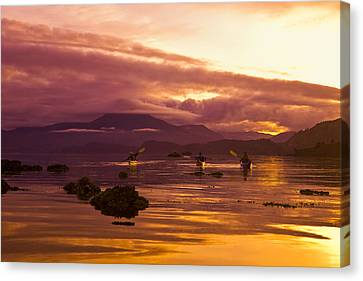 Sea Kayakers Paddle Around Near Island Canvas Print by Michael DeYoung