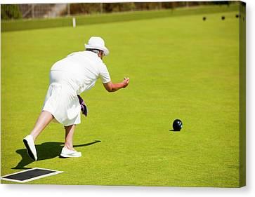 Seniors Playing Bowls At Penzance Canvas Print by Ashley Cooper