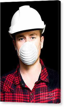 Serious Young Male Artisan Wearing Protective Mask Canvas Print by Jorgo Photography - Wall Art Gallery