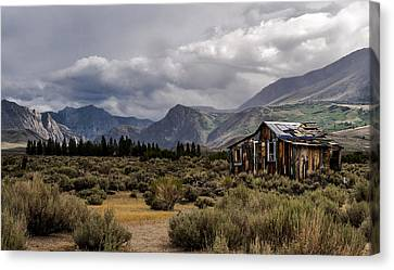 Shack In The Mountains Canvas Print by Cat Connor