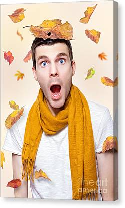 Shocked Man Playing In Falling Autumn Leaves Canvas Print by Jorgo Photography - Wall Art Gallery