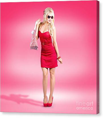 Shop Till You Drop. Female Retail Shopper In Red Canvas Print by Jorgo Photography - Wall Art Gallery