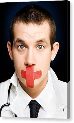 Silent Handsome Doctor With Cross Bandage On Face Canvas Print by Jorgo Photography - Wall Art Gallery
