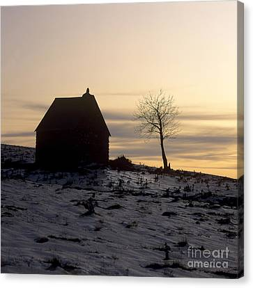 Silhouette Of A Farm And A Tree. Cezallier. Auvergne. France Canvas Print by Bernard Jaubert