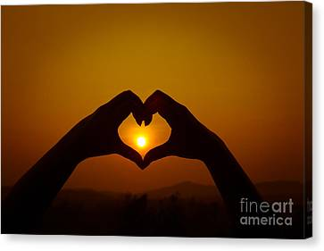Canvas Print featuring the photograph Silhouettes Hand Heart Shaped by Tosporn Preede