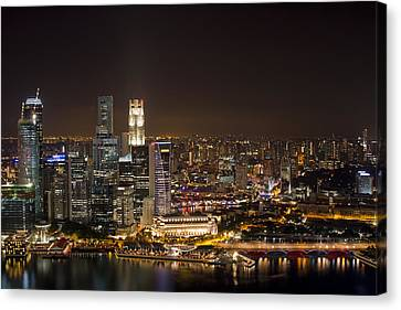 Singapore City Skyline At Night Canvas Print by David Gn