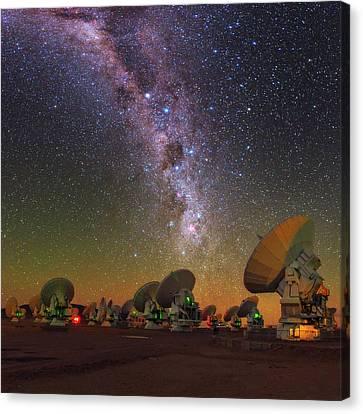 Sky Above Alma Radio Telescope Canvas Print by Babak Tafreshi