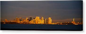 Skyscrapers And A Statue Canvas Print by Panoramic Images