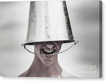 Smiling Man Laughing With Ice Bucket On Head Canvas Print