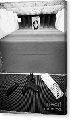 Smith And Wesson 9mm Handgun With Ammunition At A Gun Range In Florida Usa Canvas Print by Joe Fox