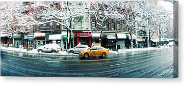 Snow Covered Cars Parked On The Street Canvas Print by Panoramic Images
