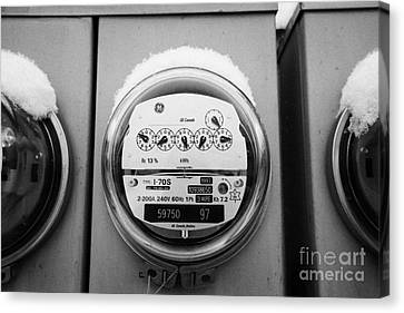 snow covered electricity meters in Saskatoon Saskatchewan Canada Canvas Print by Joe Fox