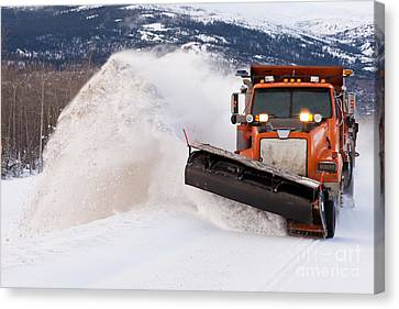 Snow Plough Clearing Road In Winter Storm Blizzard Canvas Print by Stephan Pietzko