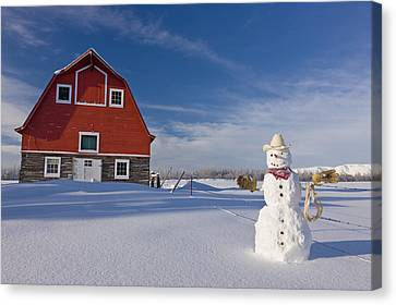 Snowman Dressed Up As A Cowboy Standing Canvas Print
