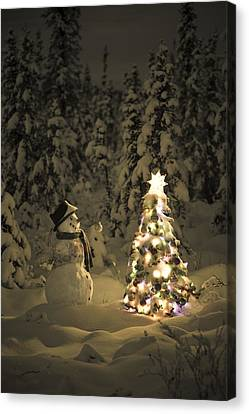 Snowman Stands In A Snowcovered Spruce Canvas Print by Kevin Smith