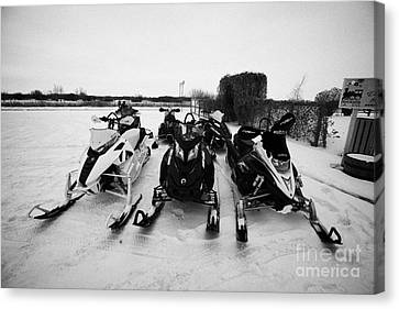 snowmobiles parked in Kamsack Saskatchewan Canada Canvas Print