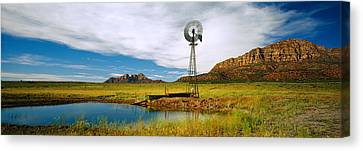 Solitary Windmill Near A Pond, U.s Canvas Print by Panoramic Images