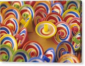 Spinning Tops Canvas Print by Jim Corwin