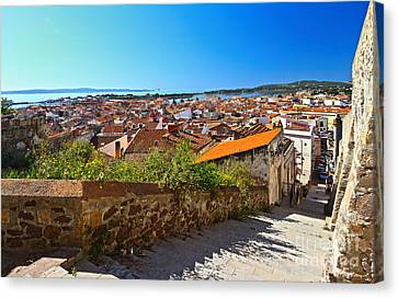 stairway and ancient walls in Carloforte Canvas Print by Antonio Scarpi