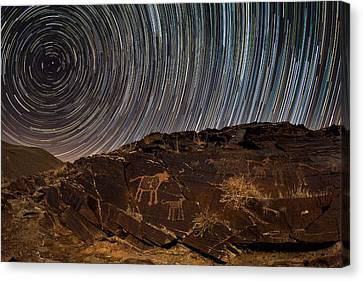 Star Trails Over Rock Carvings Canvas Print by Babak Tafreshi