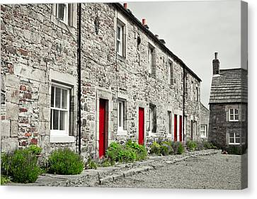 Stone Cottages Canvas Print by Tom Gowanlock