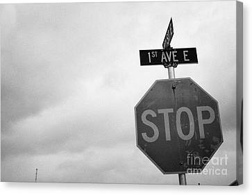 stop sign at junction of first street and first avenue on a cold grey day assiniboia Saskatchewan Ca Canvas Print