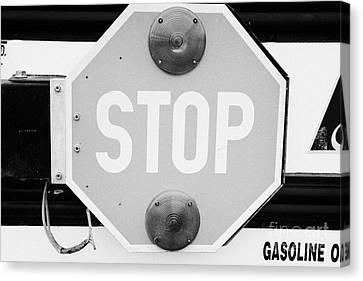 stop sign on a type a gmc north american short yellow school bus Saskatchewan Canada Canvas Print