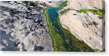 Stream Flowing Through A Rocky Canvas Print by Panoramic Images