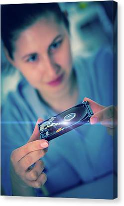 Student Holding Hdd Canvas Print by Wladimir Bulgar