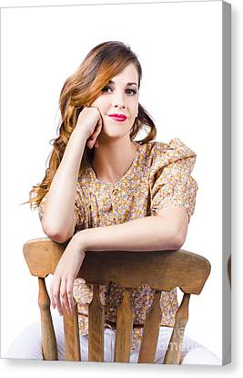 Stylish Girl At Rest On Antique Chair Canvas Print