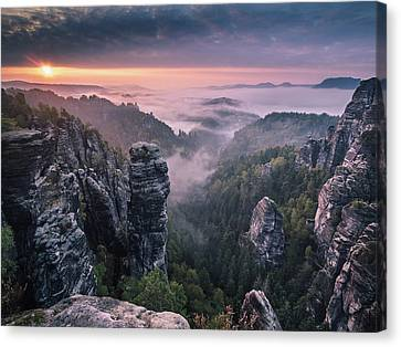 Sunrise On The Rocks Canvas Print by Andreas Wonisch