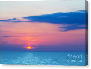 Sunset By The Sea Canvas Print by Michal Bednarek
