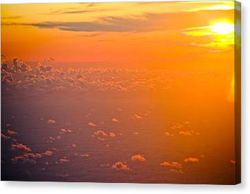 Sunset In The Sky Canvas Print by Raimond Klavins