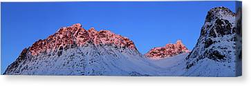 Sunset In Norway Canvas Print - Sunset Shines On Snow Covered Rugged by Babak Tafreshi