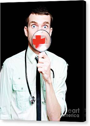 Surprised Doctor Showing Health Care Cross Canvas Print by Jorgo Photography - Wall Art Gallery