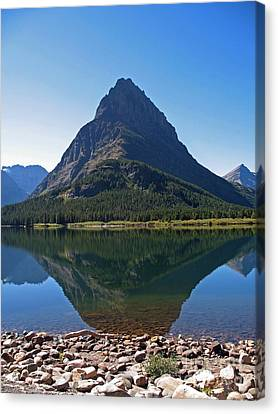 Canvas Print featuring the photograph Swiftcurrent  Lake Many Glacier by Joseph J Stevens