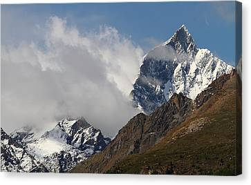 Swiss Alps Shrouded In Clouds Canvas Print by Jetson Nguyen