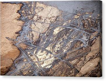 Oil Slick Canvas Print - Tailings Pond At A Tar Sands Mine by Ashley Cooper