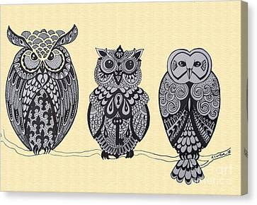 Three Owls On A Branch Canvas Print by Karen Larter