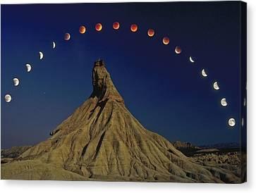 Navarre Canvas Print - Total Lunar Eclipse by Juan Carlos Casado (starryearth.com)