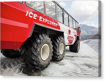 Tourist Ice Buggies On Athabasca Glacier Canvas Print by Ashley Cooper