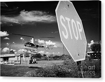 Tourist Light Helicopter Landing Behind Stop Sign Kissimmee Florida Usa Canvas Print