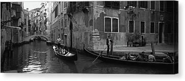 Tourists In A Gondola, Venice, Italy Canvas Print