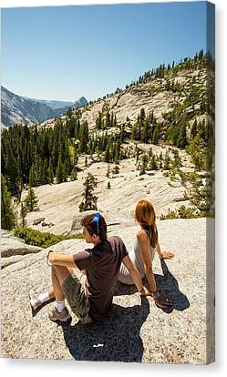 Tourists In Yosemite National Park Canvas Print by Ashley Cooper