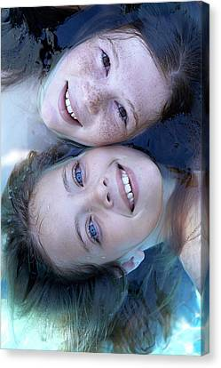 Two Girls Floating In Water Canvas Print