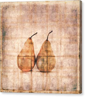 Two Yellow Pears On Folded Linen Canvas Print by Carol Leigh
