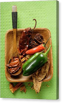 Wooden Bowl Canvas Print - Various Dried And Fresh Chili Peppers by Foodcollection