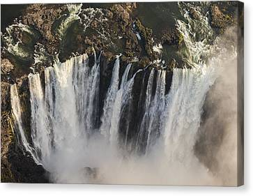 Victoria Falls And Rainbow Zimbabwe Canvas Print by Vincent Grafhorst